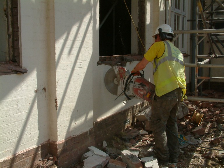 Cutting through a wall at Bude and Stratton school with a diamond blade.